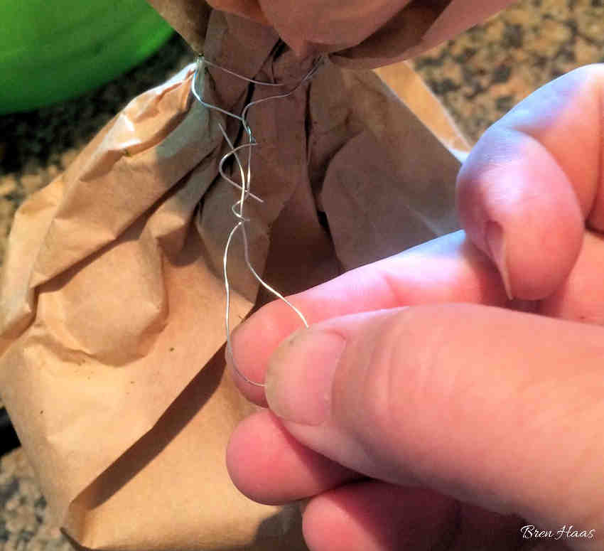 Use Wire to Tie Top of Brown Bag