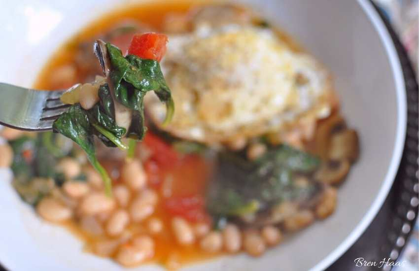 comfort food - eggs, spinach, tomato and white bean