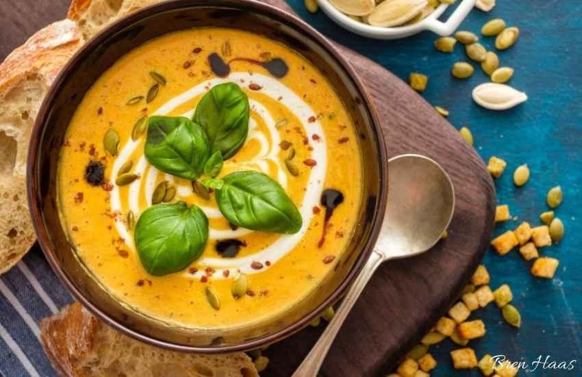 pumpkin soup with basil garnish