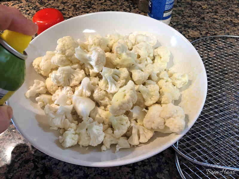 Spray Olive Oil on Cauliflower