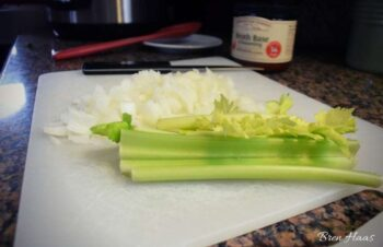 celery and onion on cutting board