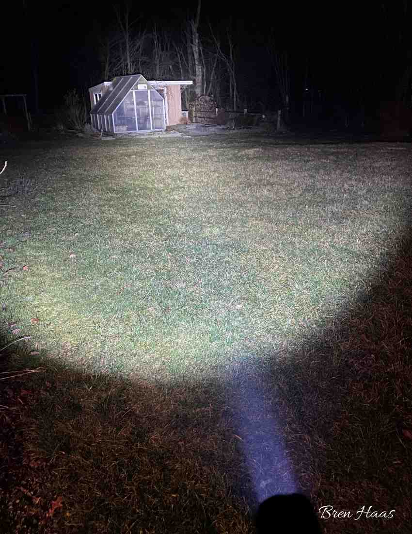 fenix flashlight lighting up over 100 feet from backdoor